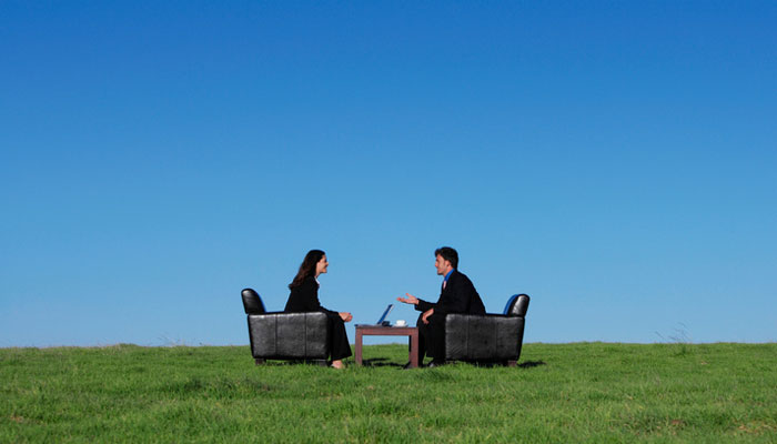 business-people-talking-in-field.jpg
