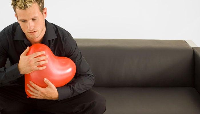 man-holding-heart-balloon.jpg