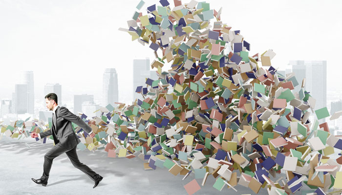 man-running-from-wave-of-books.jpg