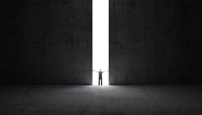 man-standing-in-doorway-of-light.jpg