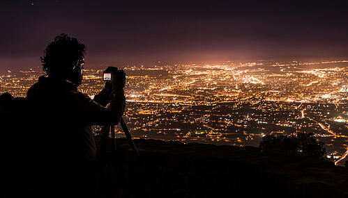 man-taking-pictures-of-city.jpg