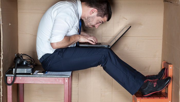 man-working-in-small-box.jpg