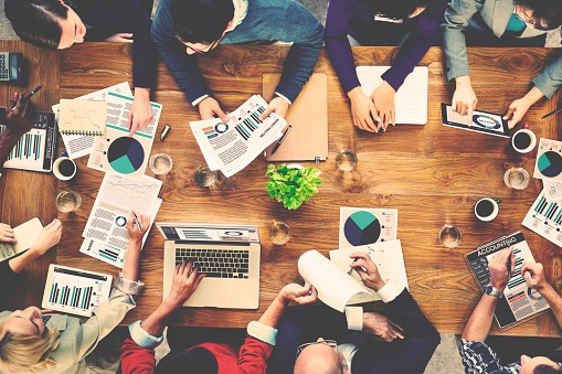 team-meeting-with-laptops.jpg