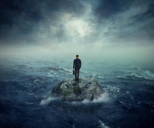 man-standing-on-rock-in-stormy-sea.jpg